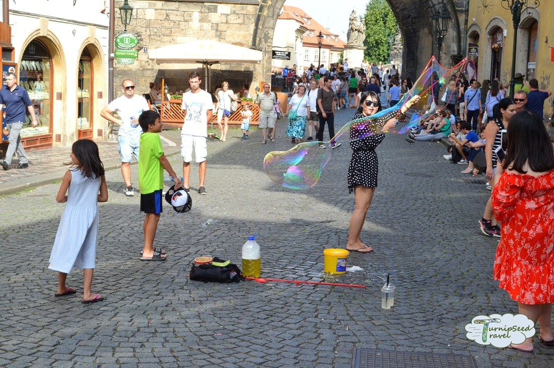 Street buskers and soap bubbles at Charles Bridge. Picture