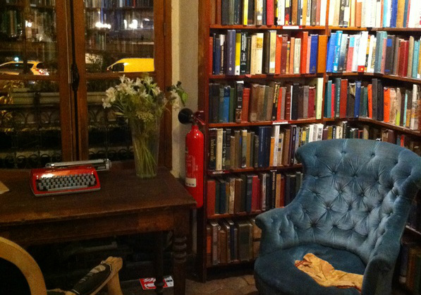 Blue armschair in a corner of Shakespeare and Company at night Picture