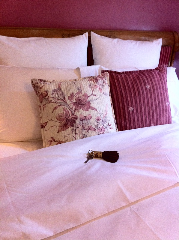 Close up of key and bed linens Hotel Academie Paris TuripseedTravel.com