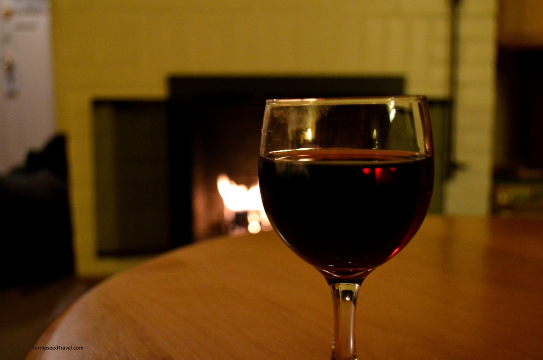Vacation wine by the fireside money saving tips