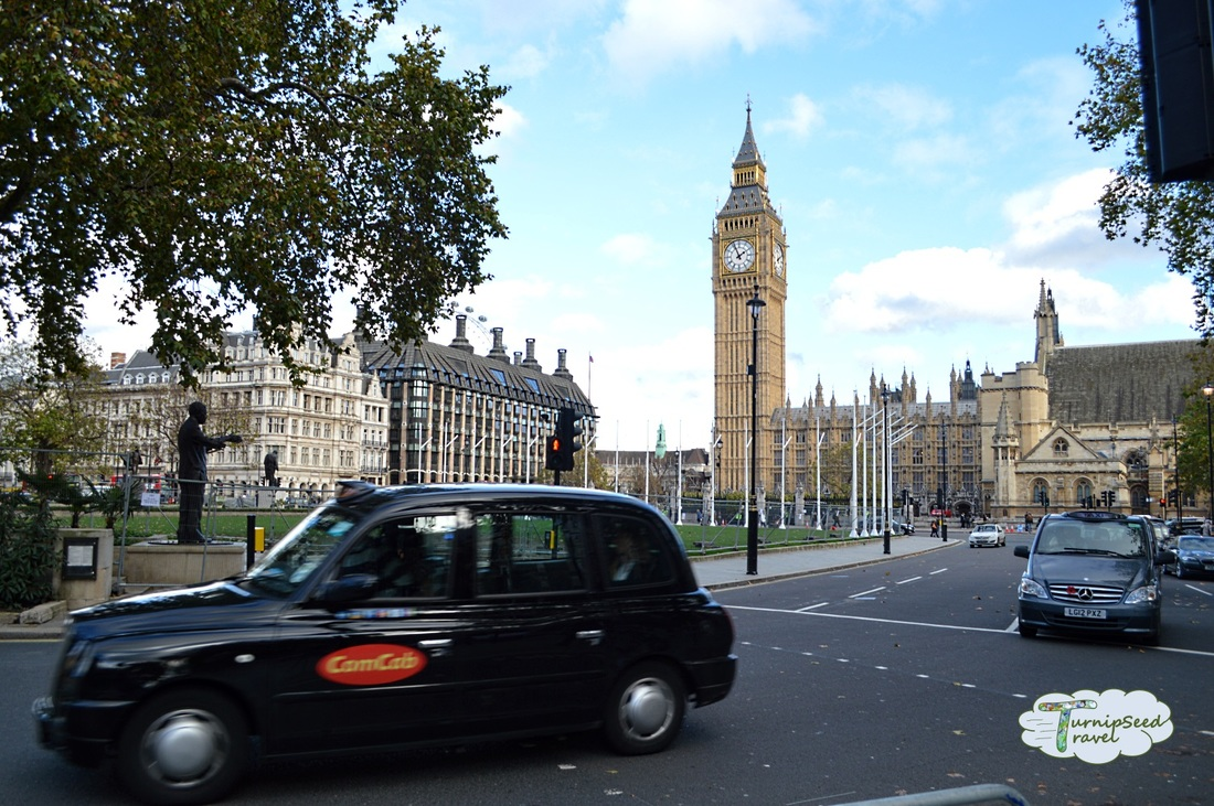 Big Ben and the British parliament with London taxi cabs Picture