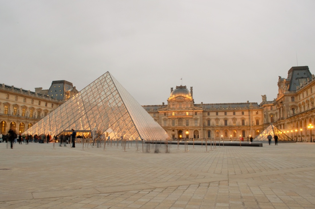 The Louvre's main entrance is the pyramid in the courtyard.  Paris TurnipseedTravel.com