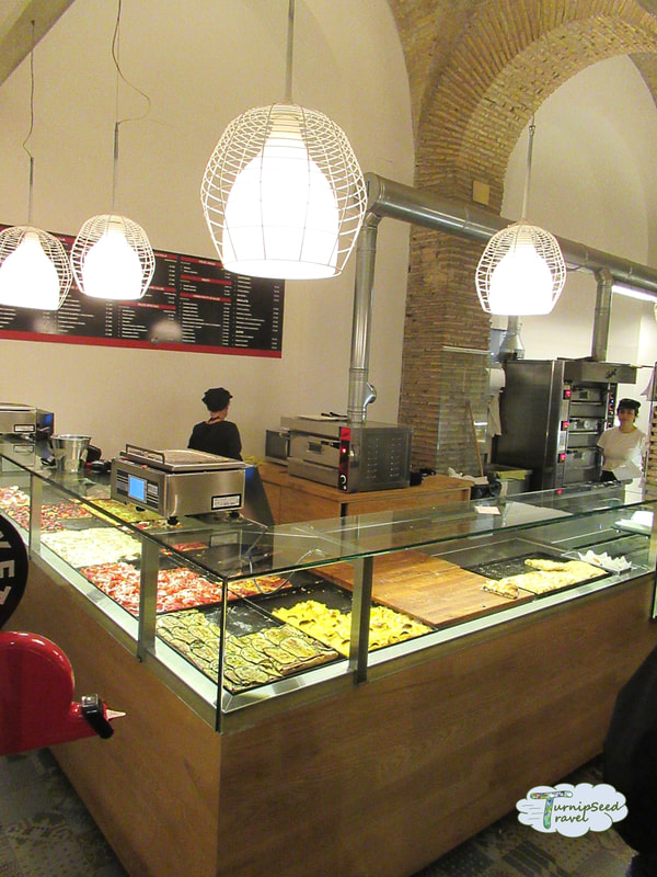 Inside Rome's yummiest food tour! Inside Alice Pizza.