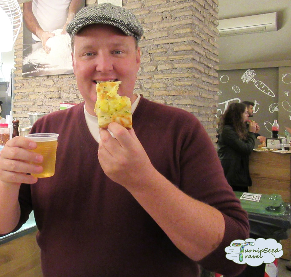 Inside Rome's yummiest food tour! Sampling potato pizza.
