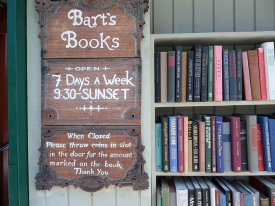 Close up of the exterior sign of Bart's Books beside a bookshelf Picture