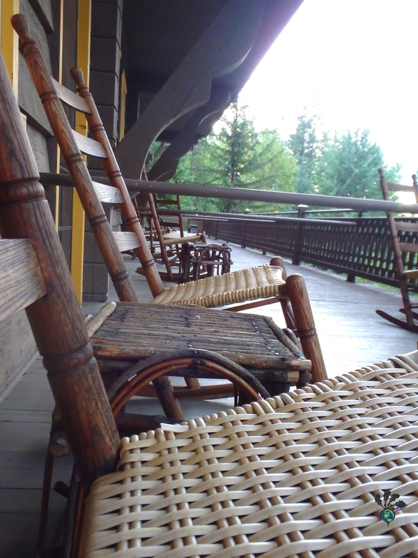 Wood and wicker chairs on the veranda of the Belton Chalet hotelPicture