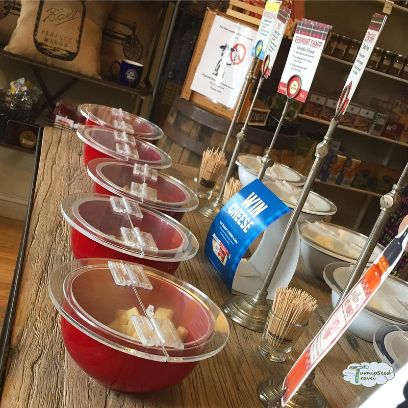 Samples of cheese at Cabot Farmer's Annex Portland Maine e