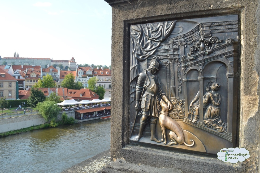 Sculpture relief of a dog Charles Bridge. Picture
