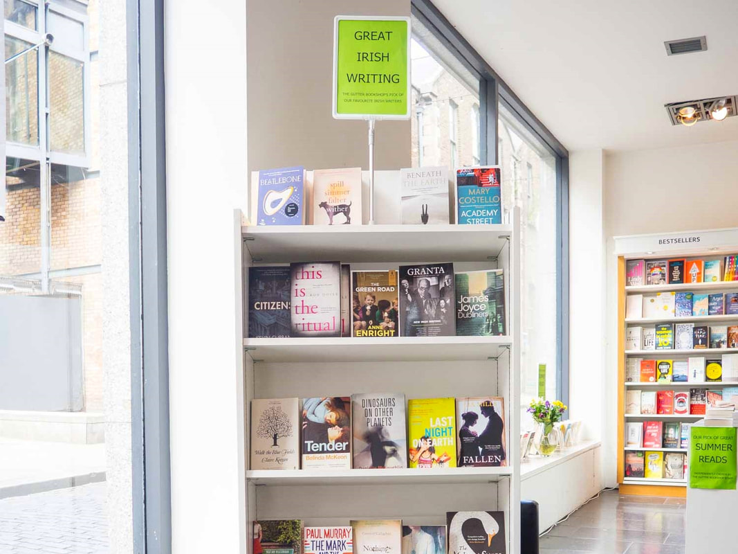 Bright white bookstore interior with a big front window and shelves of booksPicture