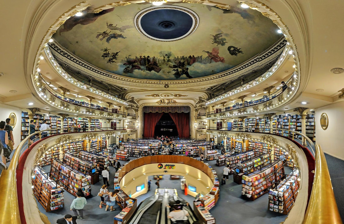Panoramic shot of the interior of the El Ateno bookstore with lit balconies and rows of bookshelves Picture