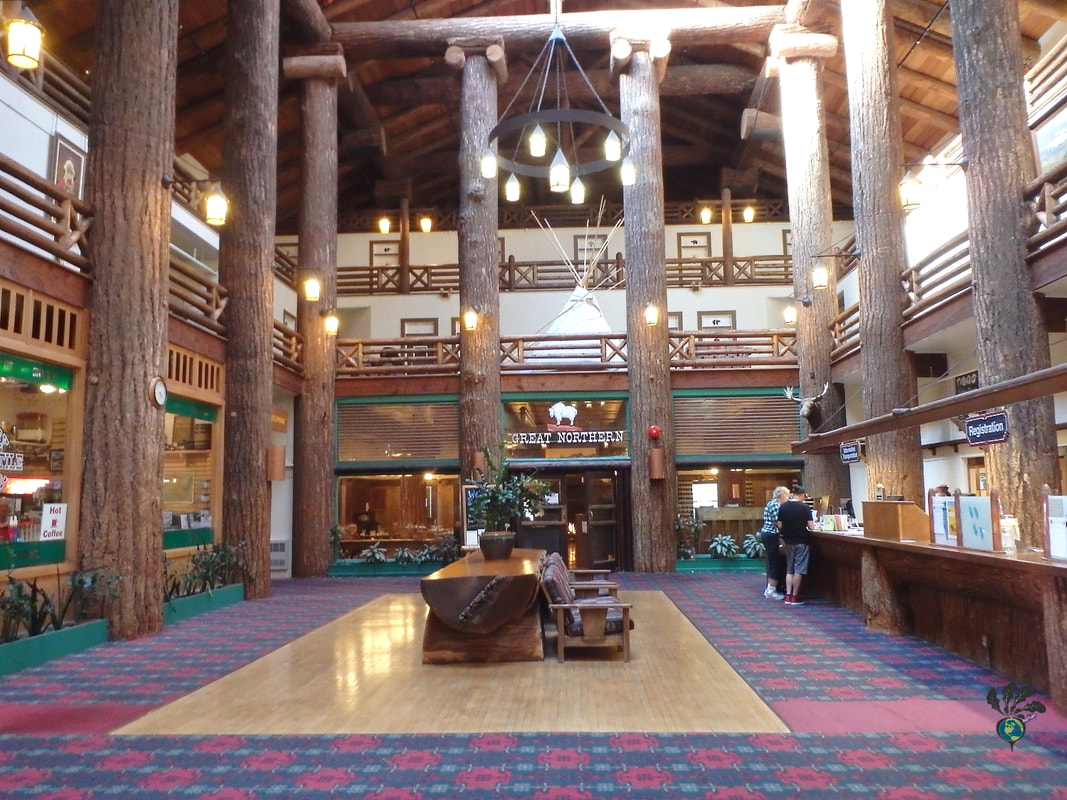 Hotel lobby with plaid carpet and high ceilings supported by giant logs Glacier Distilling and the Glacier Park Lodge's Great Northern Dining RoomPicture