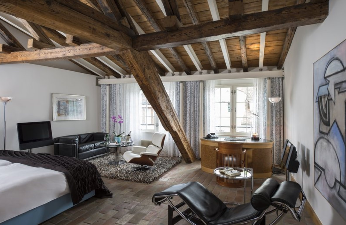 Where to stay in Zurich Deluxe room at Widder Hotel with wooden ceiling beams