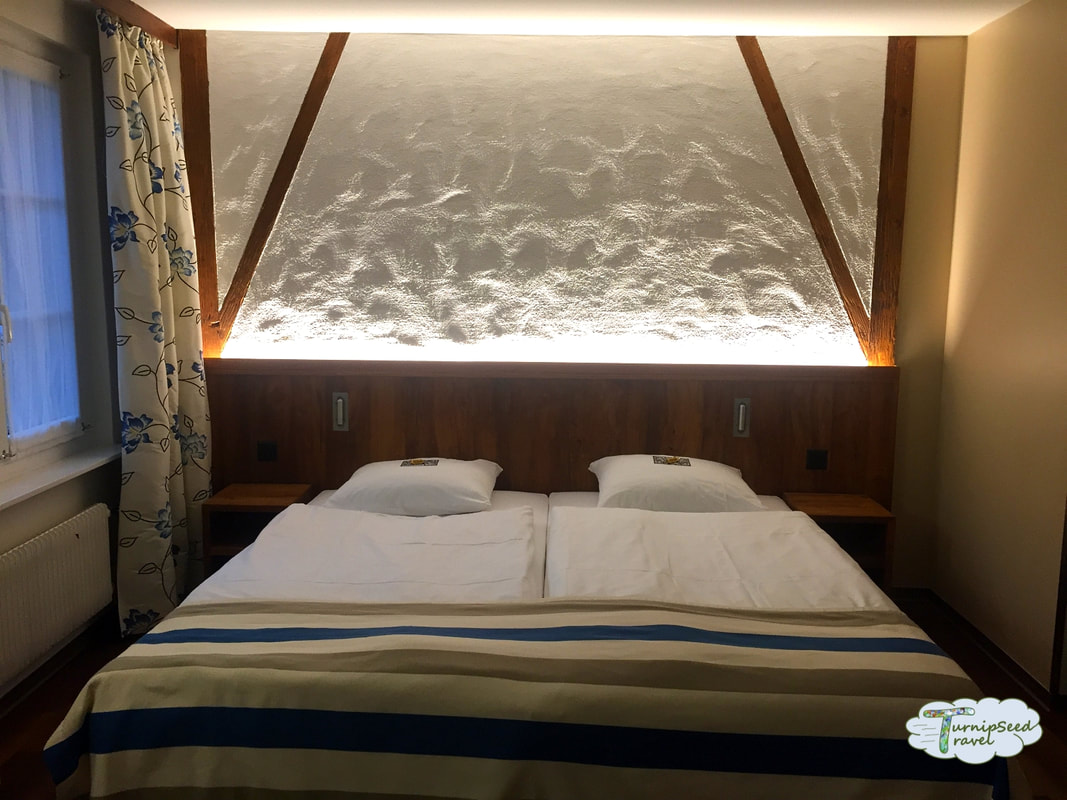 Where to stay in Zurich: White hotel bed Picture