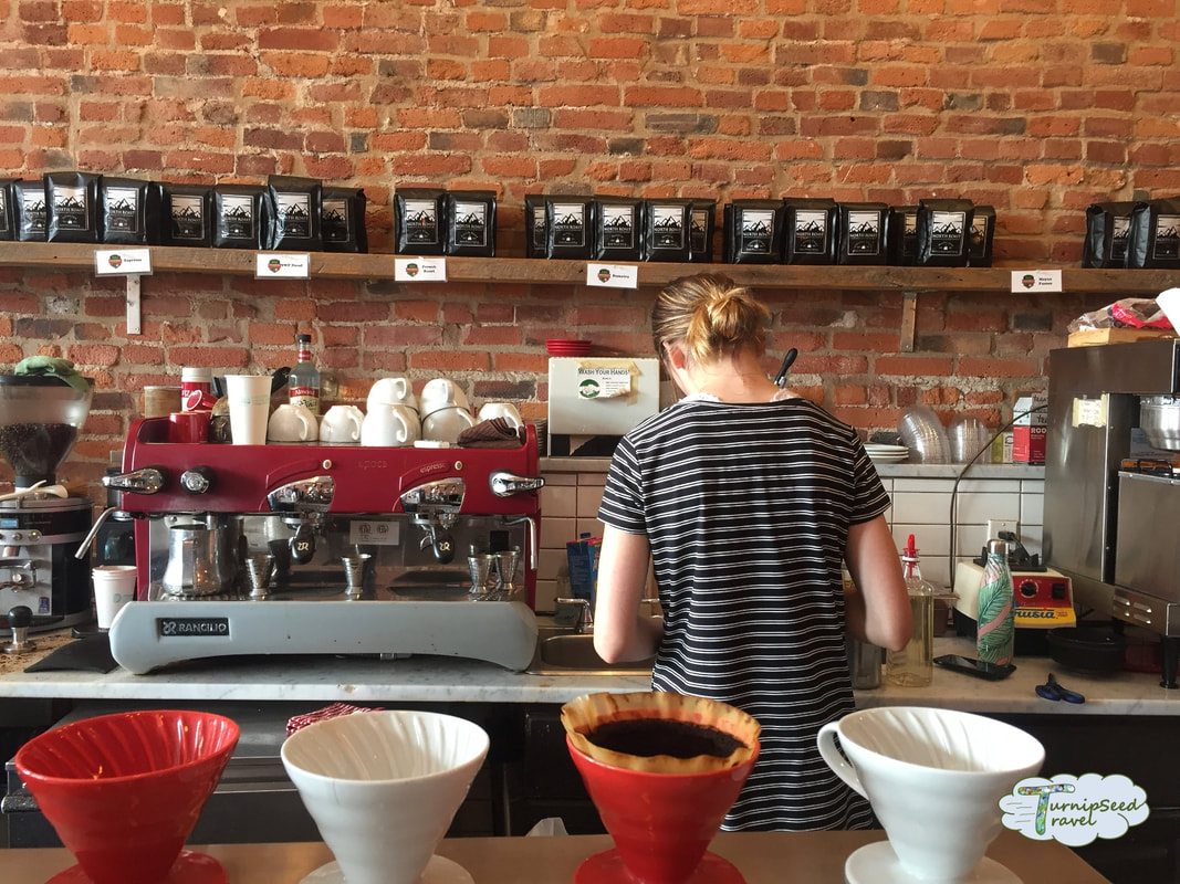 Preparing coffee at the Kingston Coffee House