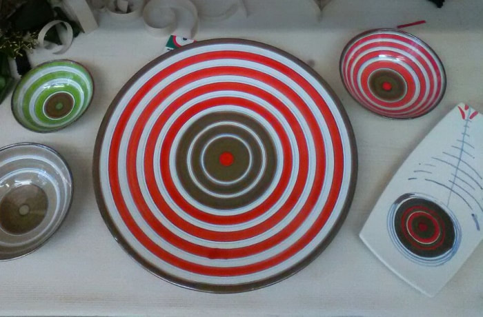 Colorful pottery with red stripes in Orvieto by TurnipseedTravel