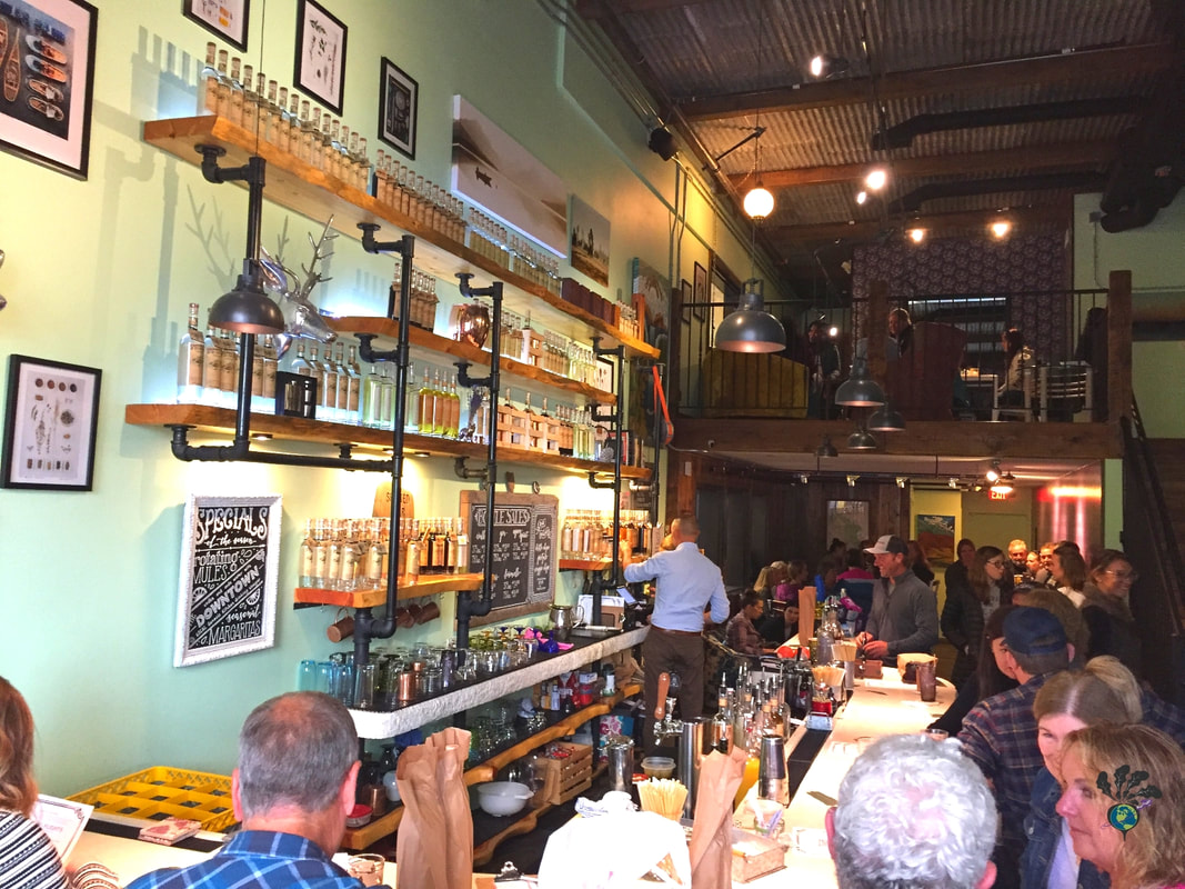 Spotted bear spirits whitefish montana: Inside of the bar at the tasting room with lots of people crowded inPicture