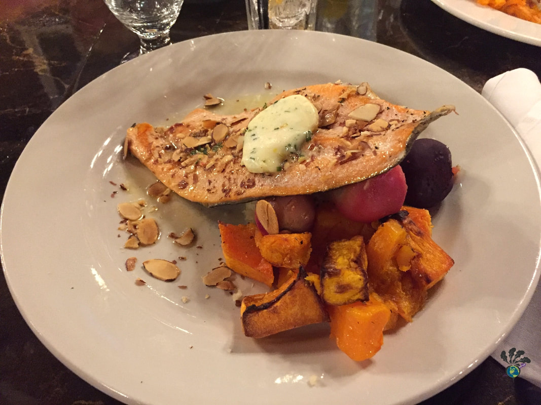 Plate of trout with almonds, potatoes, and roasted squash. Glacier Distilling and the Glacier Park Lodge's Great Northern Dining Room