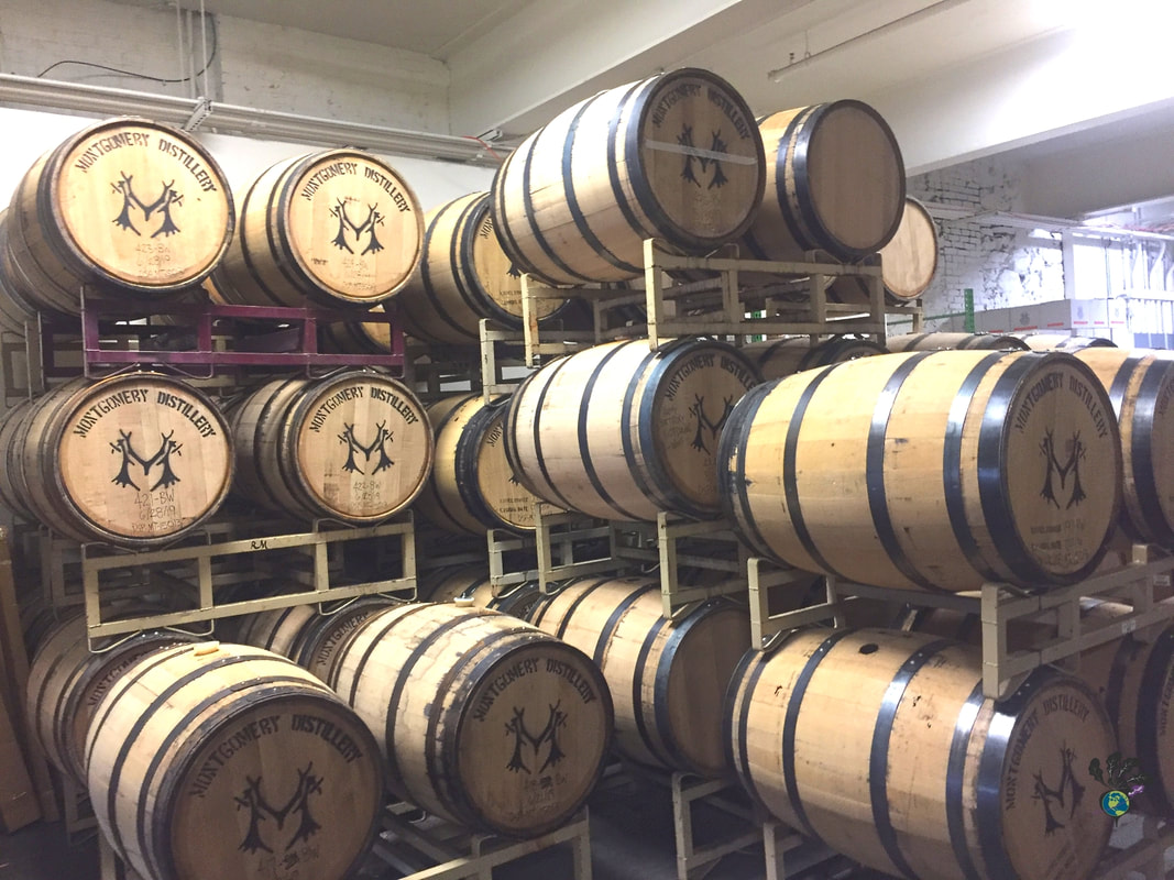Stacked wooden barrels of spirits at Montgomery DistilleryPicture