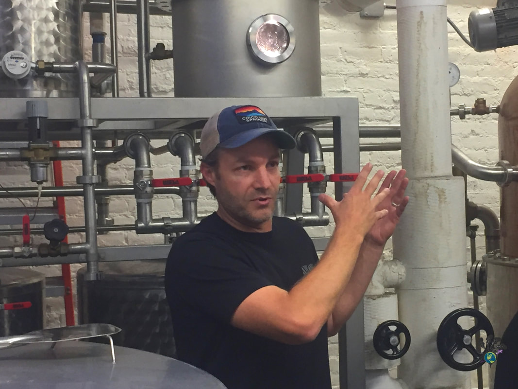 Owner Ryan describes the equipment at Montgomery Distillery in Missoula Montana Picture