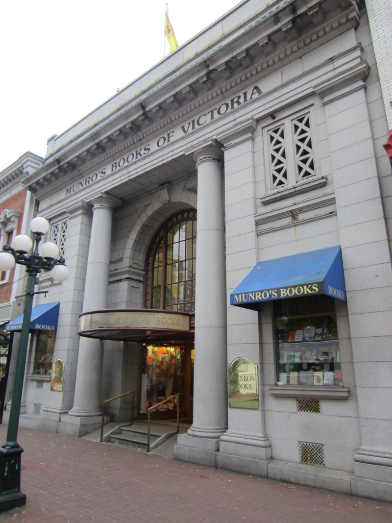 Exterior of Munro's bookstore in Victoria showing a large grey stone building with columns