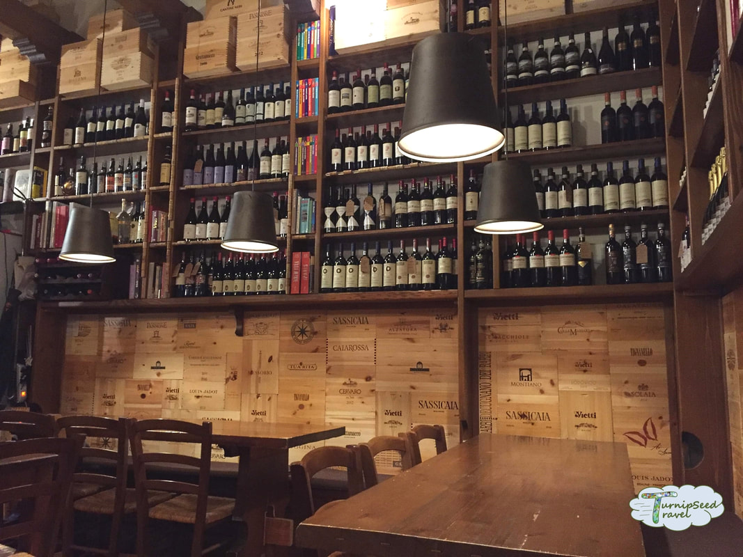 Inside a wine bar in Orvieto Italy from TurnipseedTravel.com