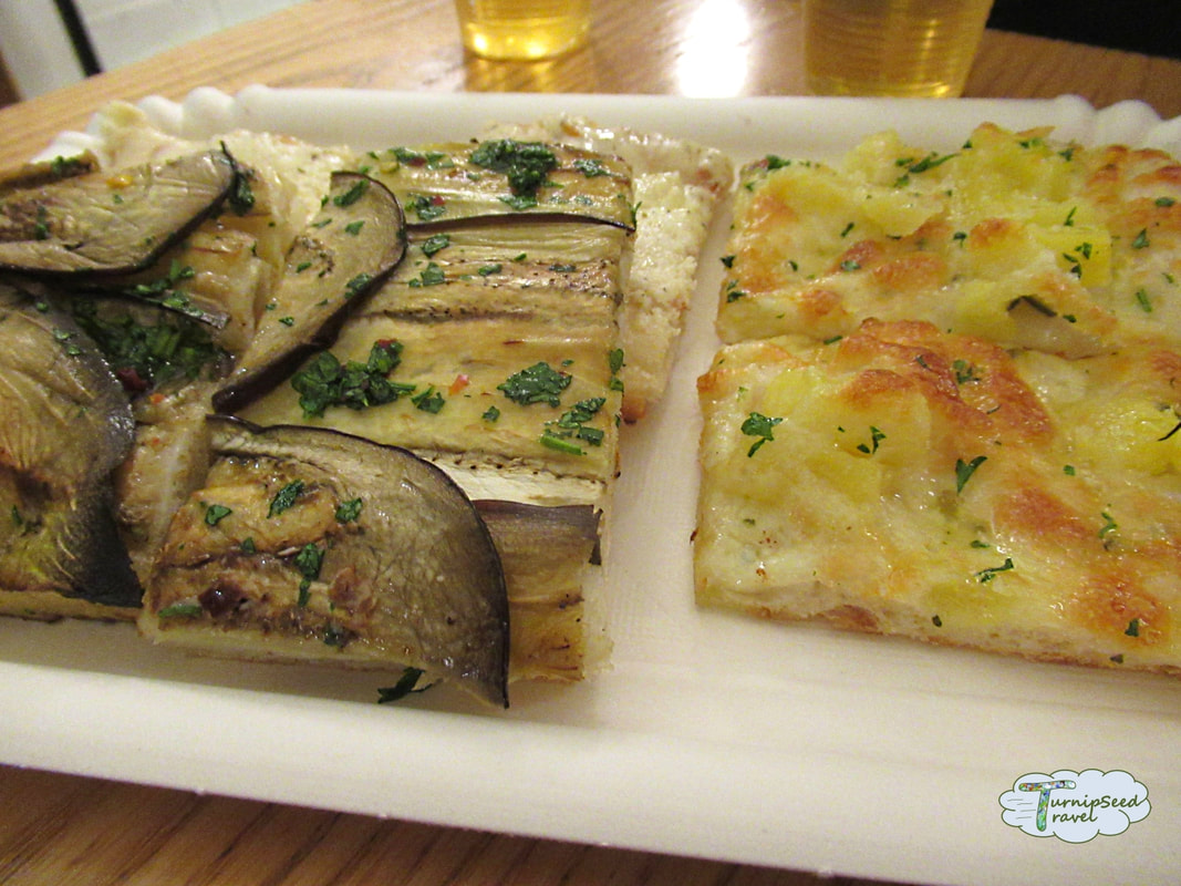 Details of our food tour, Rome: Sampling eggplant and potato pizza in Rome