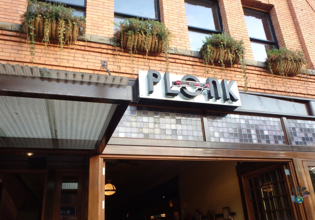 Exterior of brick building with Plonk Wine sign in Missoula MontanaPicture