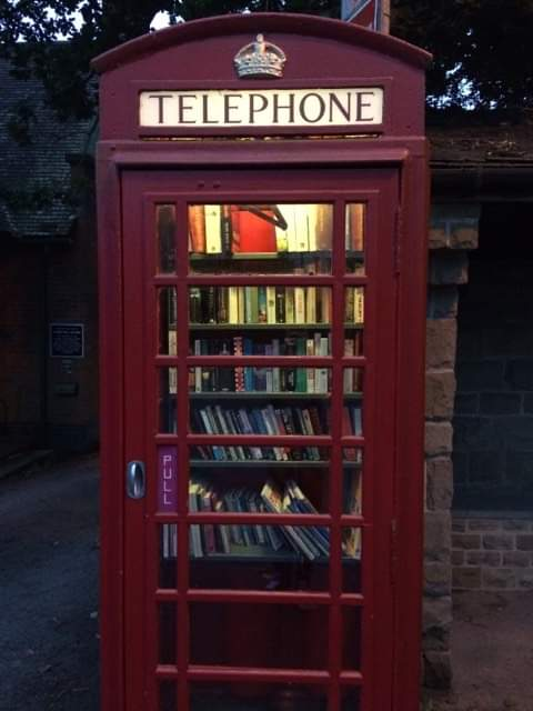 Red British phone booth transformed into a book exchangePicture
