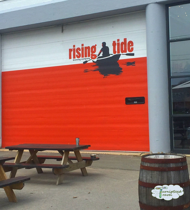 Orange front doors of Rising Tide Brewery Portland Maine re