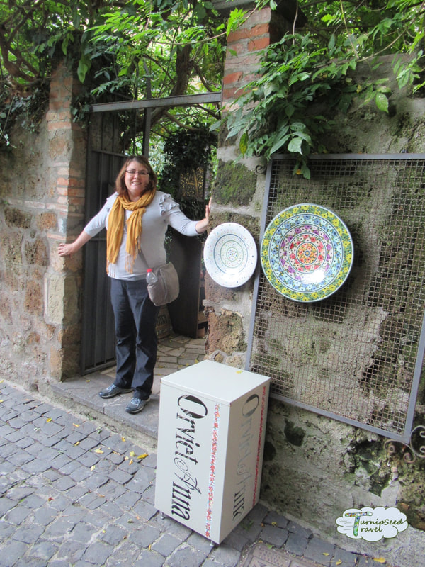 Vanessa posing outside a pottery shop in Orvieto Picture