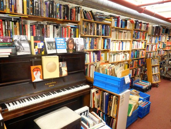Piano in the cramped music section of Skoob Books Picture