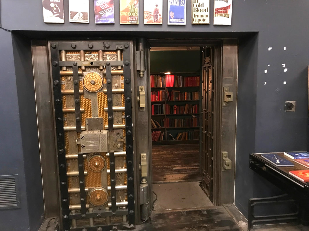 Walk in vault containing a shelf of red books Picture