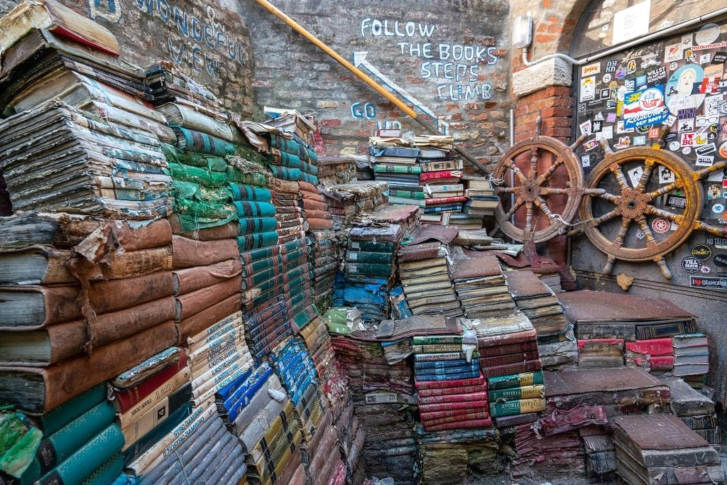 Stacks of old damaged books set up to form a staircase in Venice