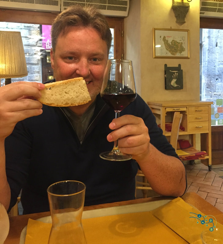 Ryan poses with wine and bread at an Orvieto winery