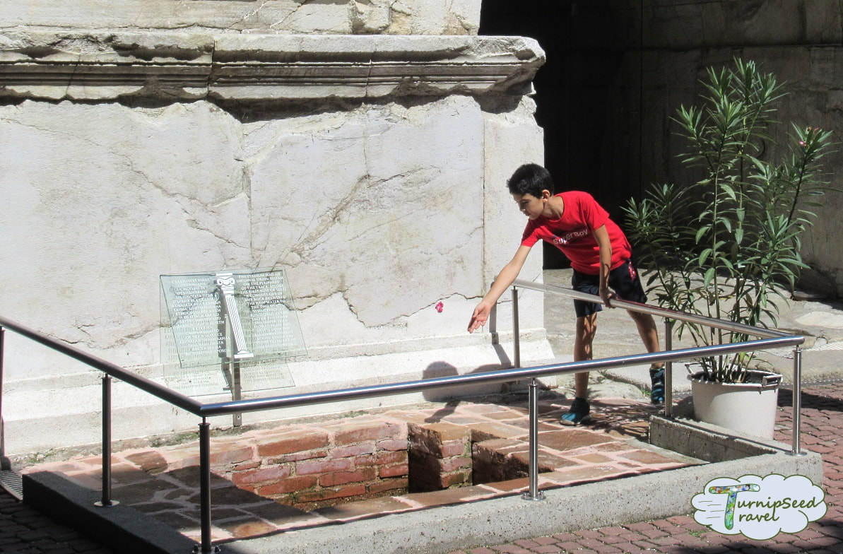 Boy at wishing well of Roman Stadium - one of the best things to do in Plovdiv Picture